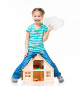 Girl with a toy house — Stock Photo