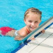 Pretty little girl in swimming... — Stock Photo