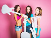 Girls with musical instruments — Stock Photo
