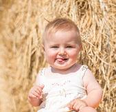 Baby on hay — Stock Photo