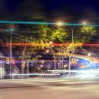Moving car with blur light through city at night — Photo
