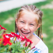 Cute little girl  flowers — Stock Photo