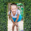 Cute little girl with the bush — Stock Photo