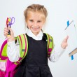 Little cute girl with a stationery — Stockfoto