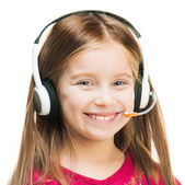 Portrait of girl in headset — Stock Photo