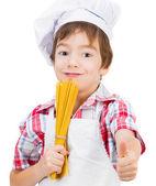 Boy with raw spaghetti — Stock Photo