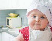 Little baby in a chef's hat — Stock Photo