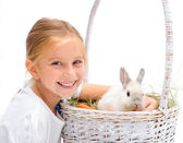 Little girl with a rabbit — Stok fotoğraf