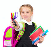 Little cute girl with a stationery — Stock Photo