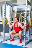 Levantador de pesas sentadillas — Foto de Stock