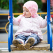 Little baby in a swing — Stock Photo #34607175