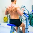Bodybuilder with simulator — Foto de Stock