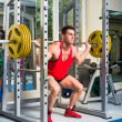 Weightlifter squats — Stock Photo