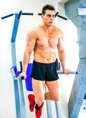 Bodybuilder doing exercises — Стоковое фото