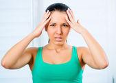 Woman with a headache — Stockfoto