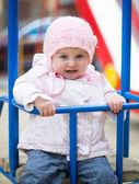 Little baby in a swing — Stock Photo