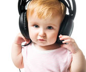 Baby in big headphones — Stock Photo