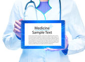 Doctor with tablet computer — Stock Photo