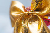Gold Christmas bow — Stock Photo