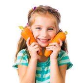 Little girl with two carrots — Stock Photo