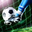 Foot kicking soccer ball — Stock Photo #40014739