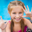 Little girl near sweaming pool — Stock Photo