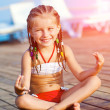 Girl in a yoga pose — Stock Photo