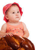 Baby girl and bread — Stock Photo