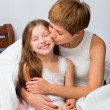 Mom hugs and kisses daughter — Stock Photo