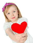 Beautiful girl holding a red  heart — Stockfoto