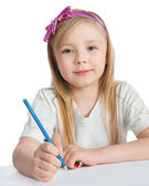 Pretty little girl paints on paper — Stock Photo