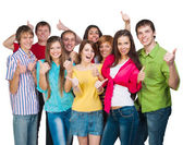 Group of smiling young people with a raised thumb — Stock Photo