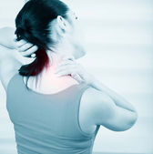 Woman pain in neck — 图库照片