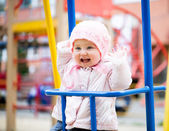 Little baby in a swing — Stock Photo
