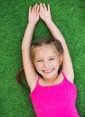 Little girl on green grass — Stock Photo