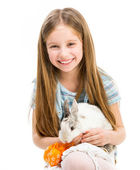 Little girl with rabbit — Stock Photo