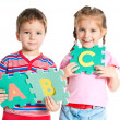 Boy and girl holding letters — Stock Photo #5741506