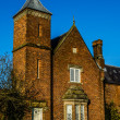 Brick built house with tower, Cheshire England — Stock Photo