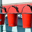 Three red buckets — Stock Photo