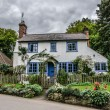 Stock Photo: Blue and white traditional english cottage