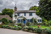 Blue and white traditional english cottage — Stock Photo