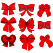 Big set of red gift bows with ribbons. Vector illustration. — Stock Vector #40063431
