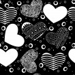 Seamless pattern of various hearts, black on white — Stock Vector