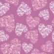 Seamless pattern of hearts — Stock Vector #21038581