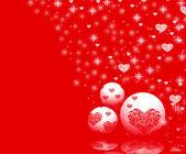 Christmas ornaments on red — Zdjęcie stockowe