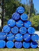 Blue plastic drums stacked — 图库照片