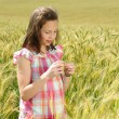 Young beautiful girl in a field of wheat — Stock Photo #12609276