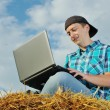 A business man in a countryside with a laptop — Stock Photo #12613280