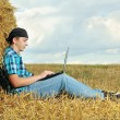A business man in a countryside with a laptop — Stock Photo