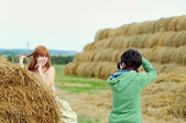 Photographer taking a shot of bride — Stock Photo